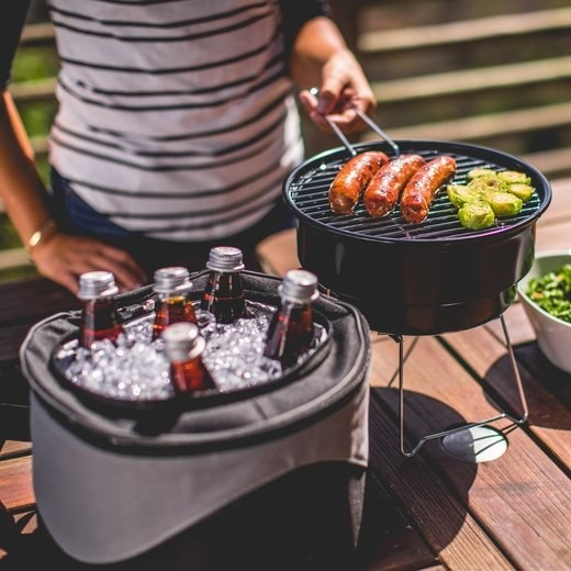 portable grill and cooler tote with beer
