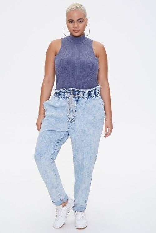 model wearing the denim joggers with sneakers and a tank