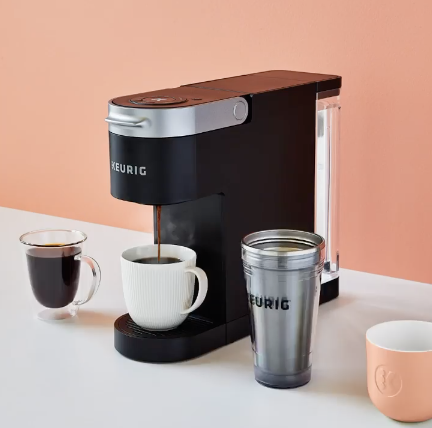 Coffee being brewed into a mug