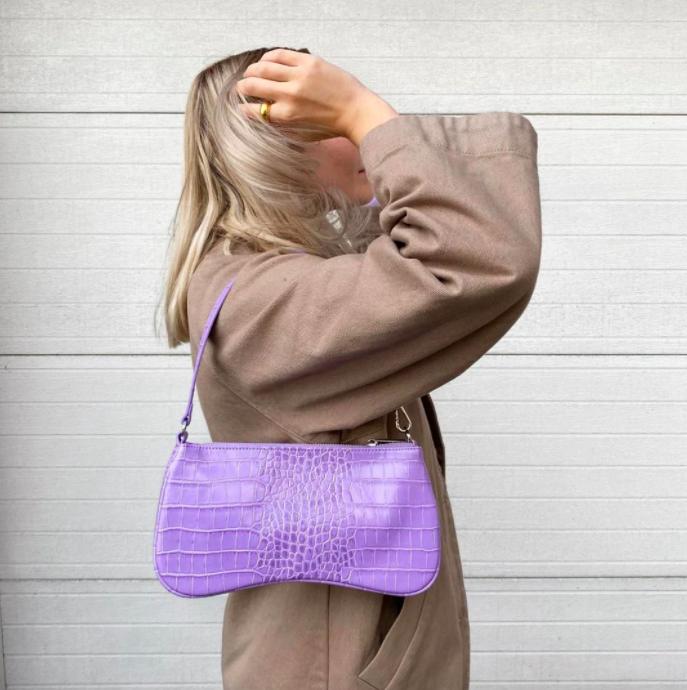 model wearing eva shoulder bag in purple