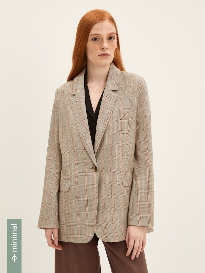 model wearing Frank And Oak plaid blazer