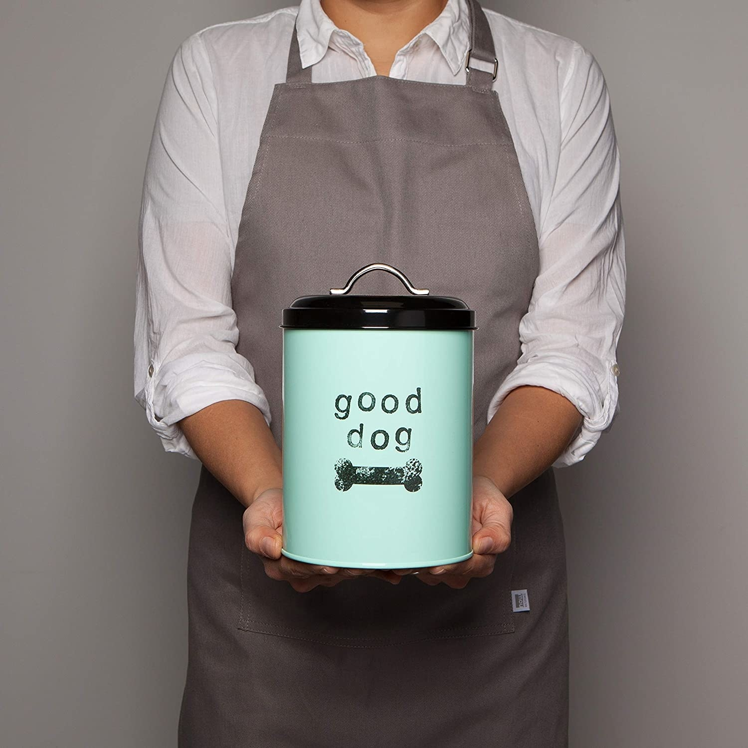A person holding the treat canister