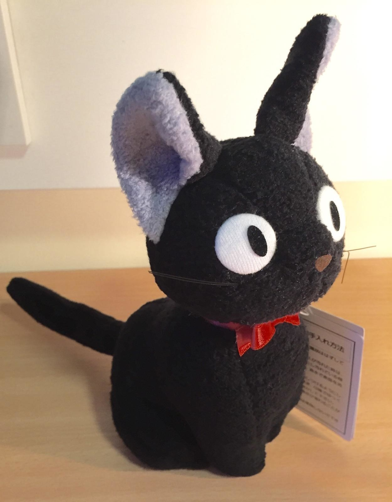 a black plush cat stuffed animal