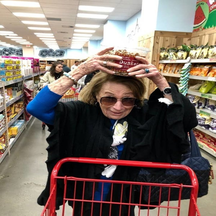 My grandma holding a box of Trader Joe's dunkers on her head.