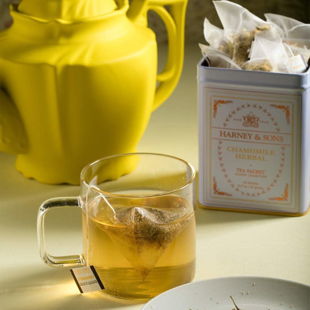 a glass mug full of chamomile tea