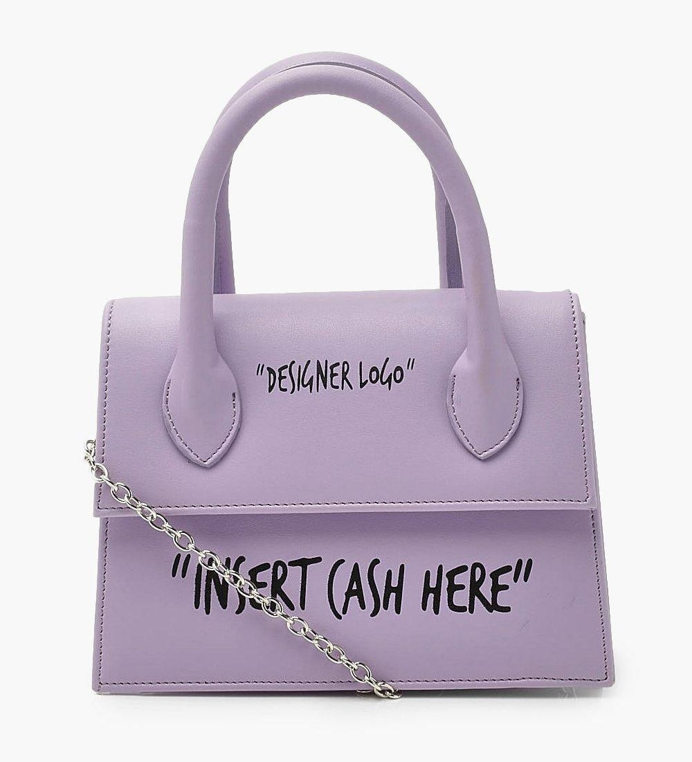 "purple purse that sayd ""designer logo"" and ""insert cash here"" in black letters"