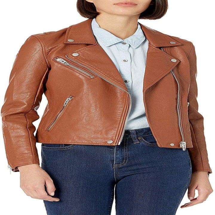 A model wearing the brown moto jacket