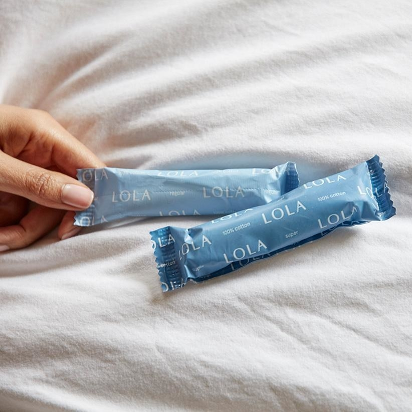 a model's hand reaches for one of two displayed LOLA tampons