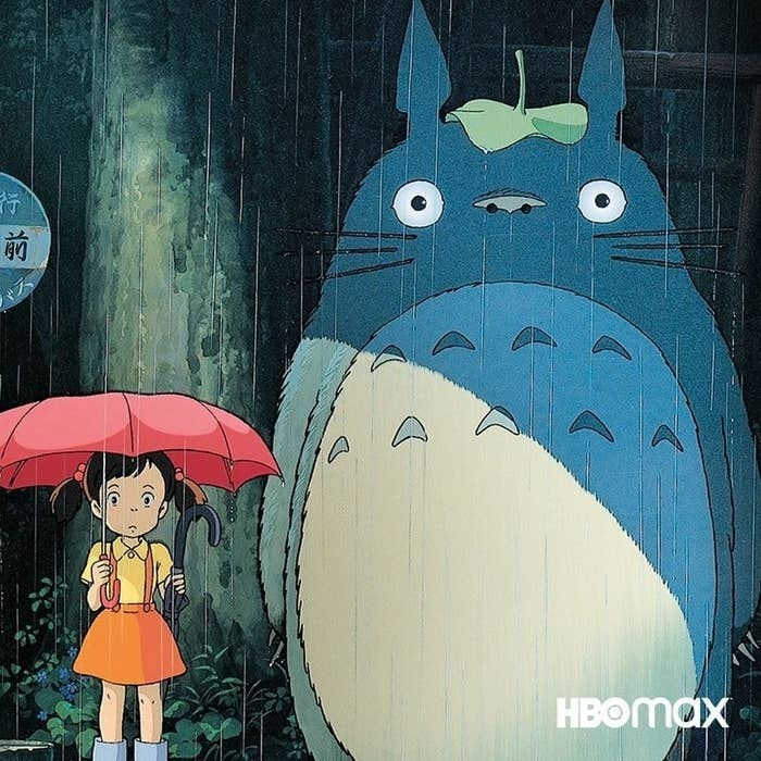 mei and totoro standing under umbrellas in the rain