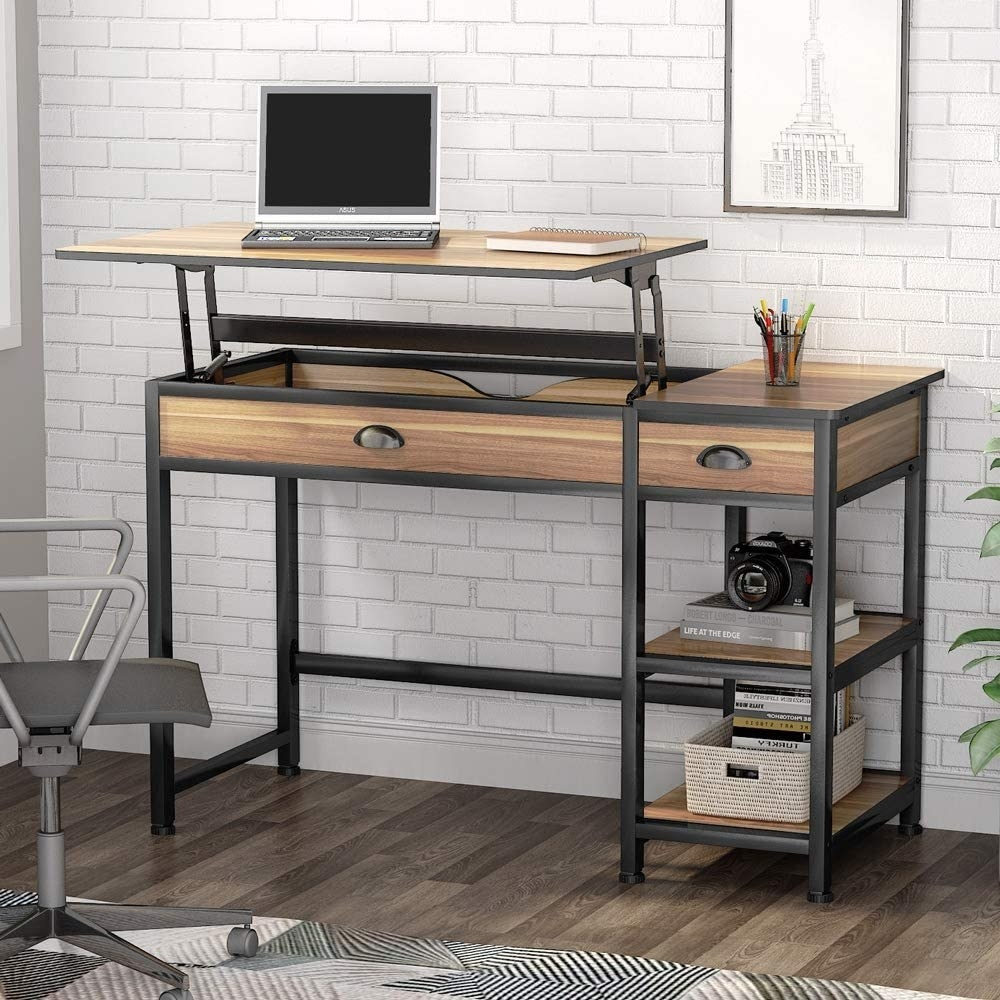 Iron and wood desk with two drawers and two bottom shelves with the top listed up to convert into a standing desk