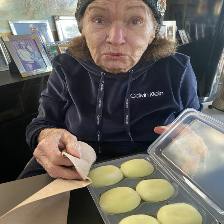 My grandma opening a package of green tea mochi.
