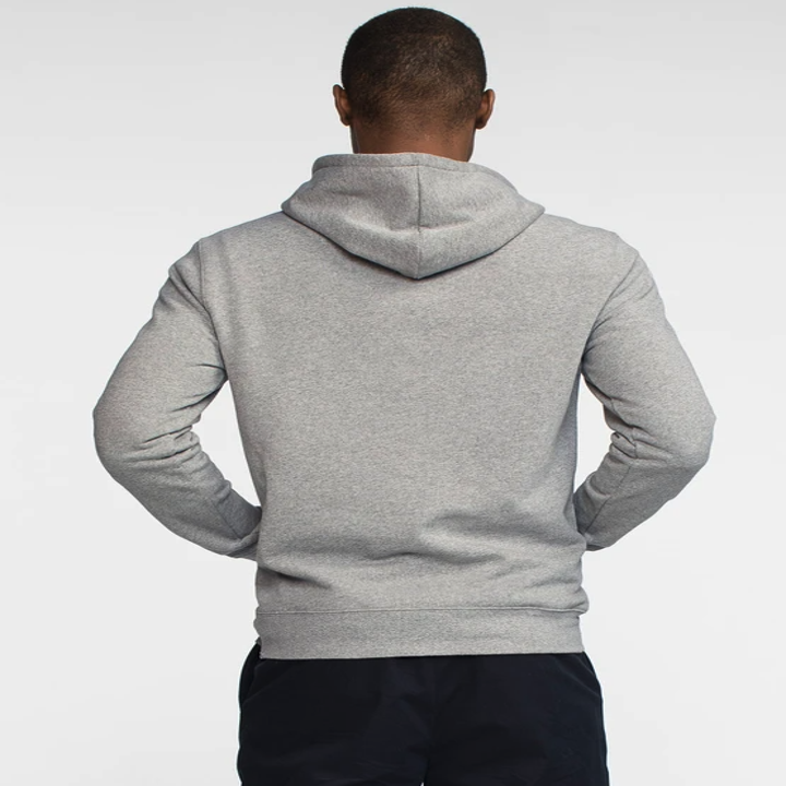 The back view of a man wearing the grey hoodie