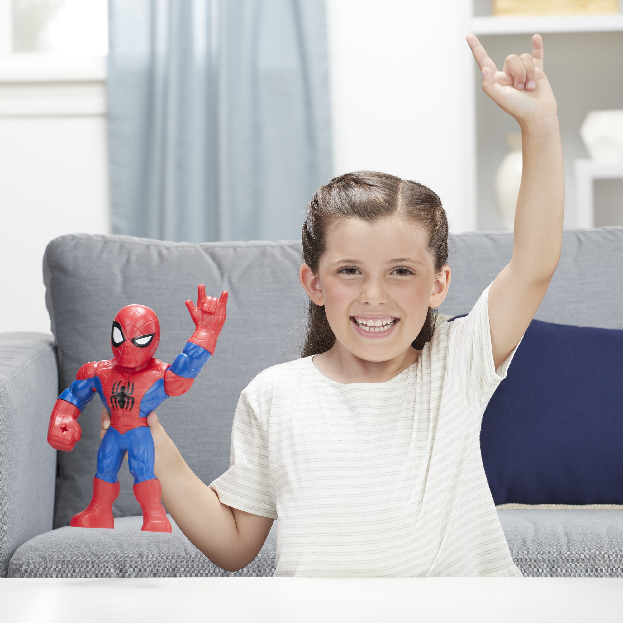 kid imitating a spider-man figure with both of their left hands up in the air with the web shooting hand signal