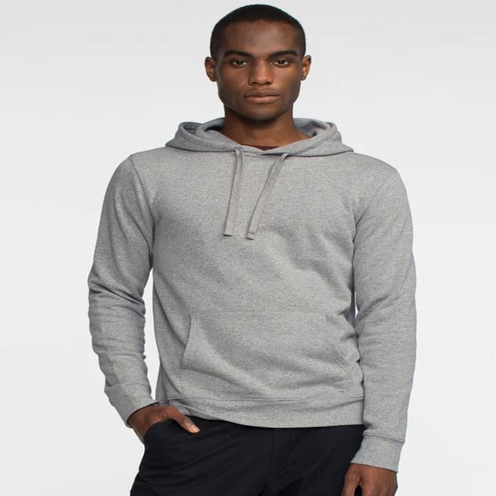 A man wearing the grey hoodie