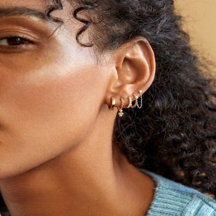 model wearing earrings from the set
