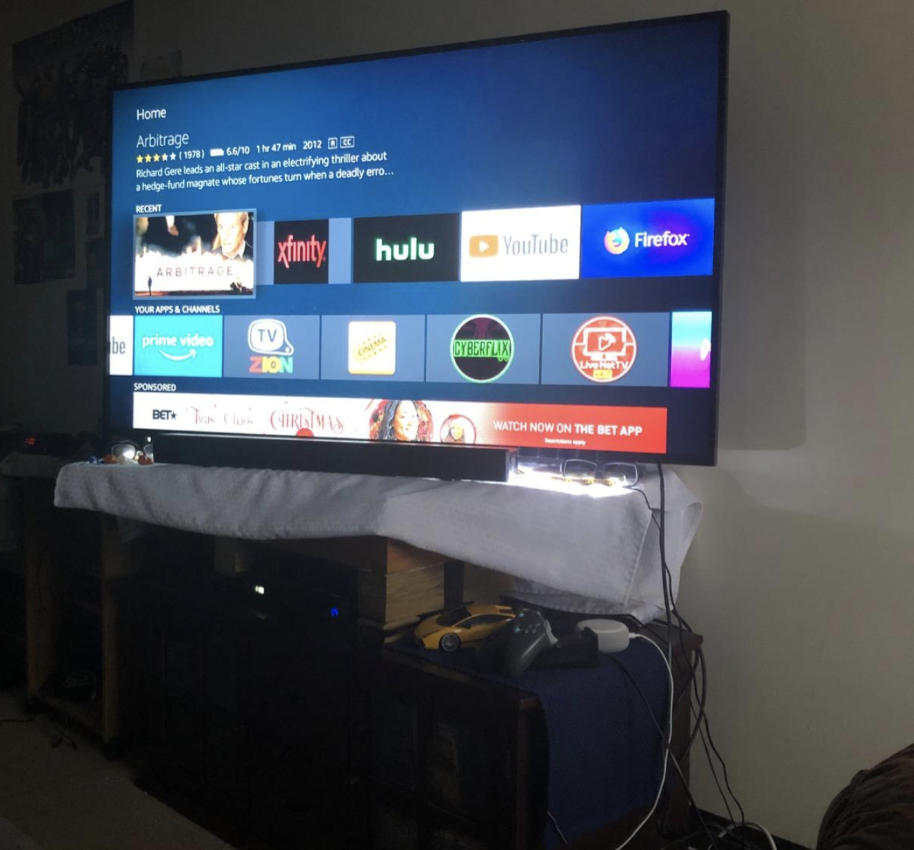 various streaming app options on a tv screen with fire stick plugged in
