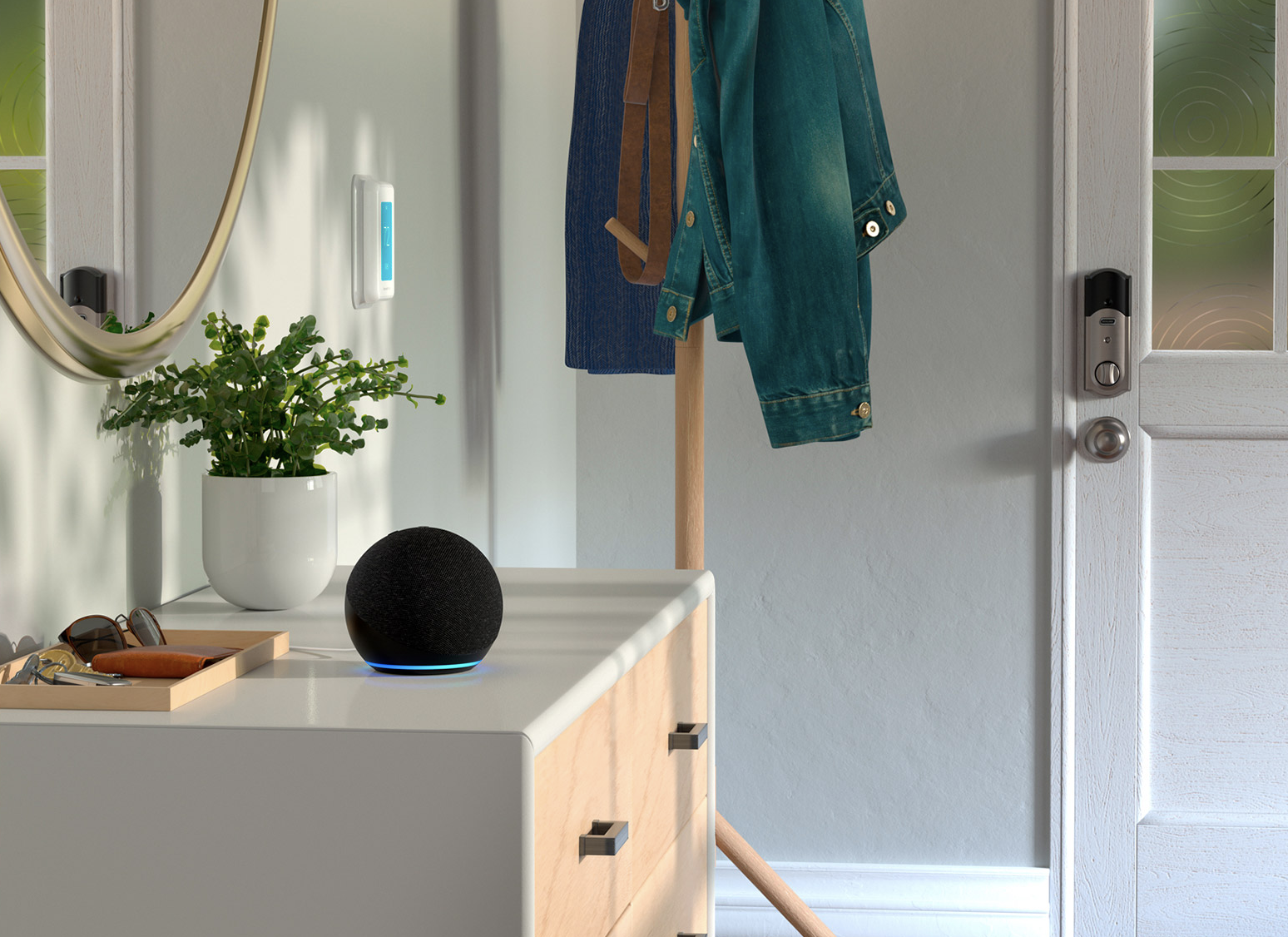 the sphere-shaped echo dot sitting on a dresser in a bedroom