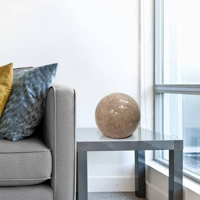 Minimalist stone ball lamp on side table