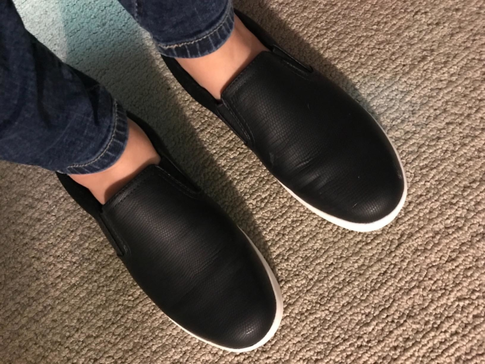 Reviewer wearing the slip-on sneakers in black