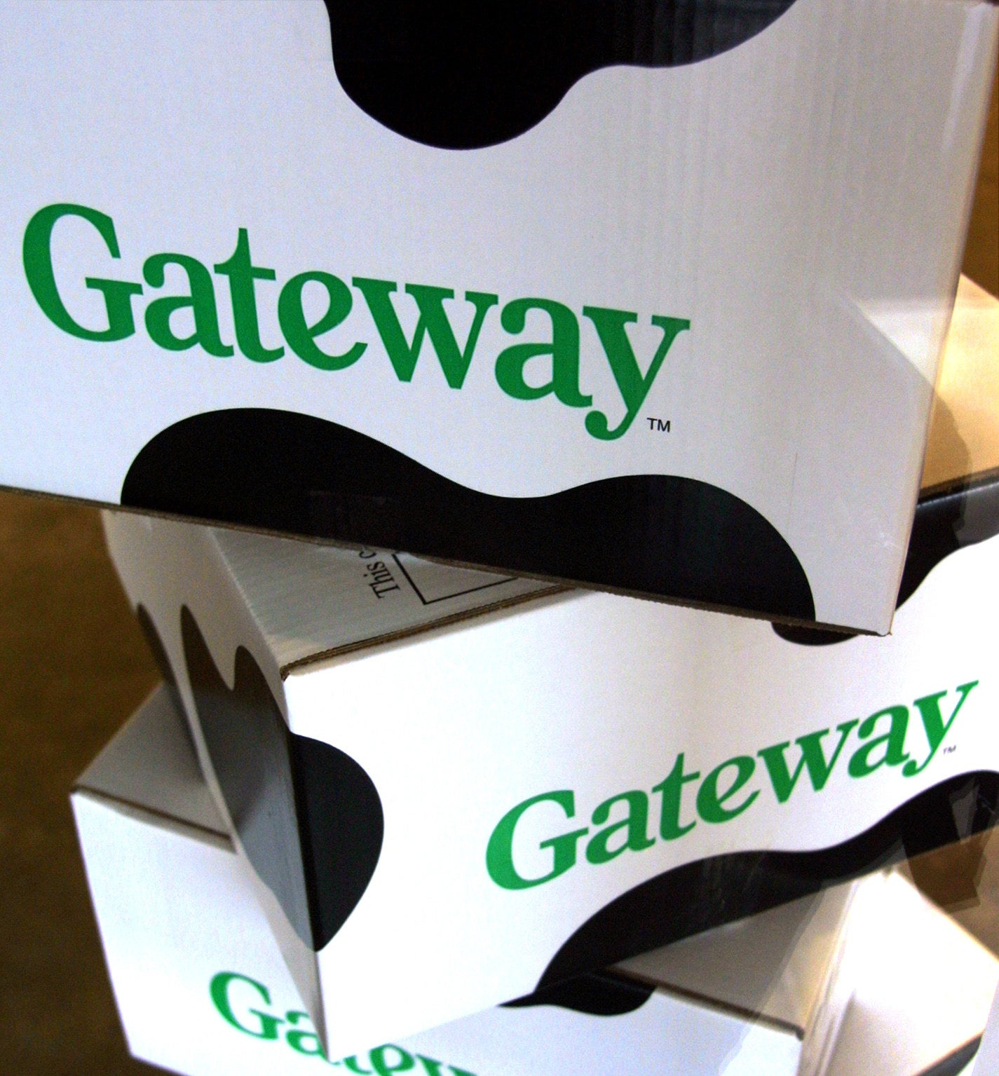 A stack of Gateway computer boxes with cow-print on them