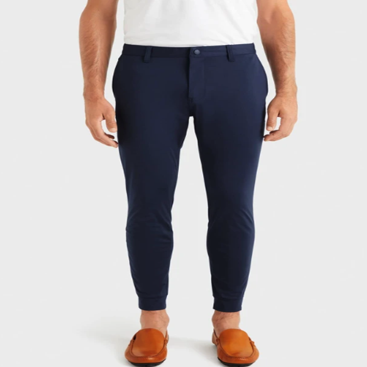 Someone wearing the fitted Commuter Jogger pants in navy