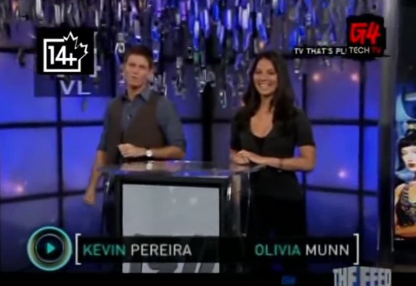 "Hosts Kevin Pereira and Olivia Munn standing on the set of ""Attack of the Show!"""