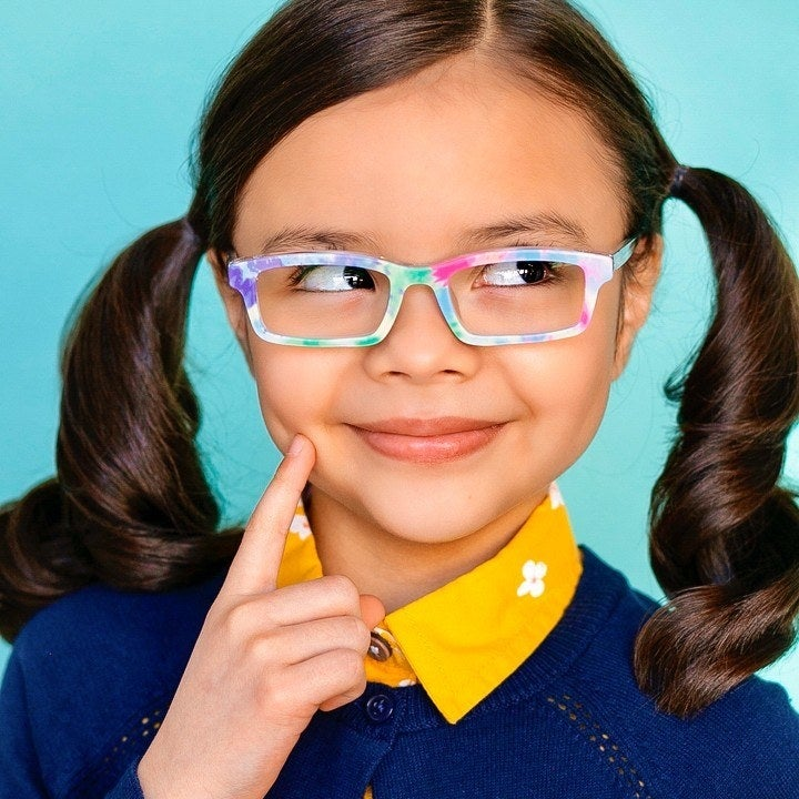 a child wearing colorful glasses