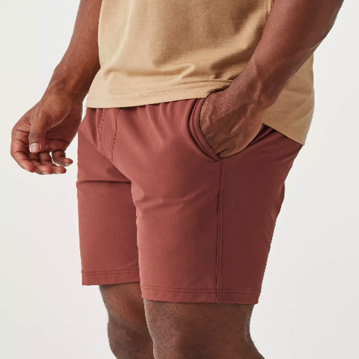 A model wearing some burnt red shorts
