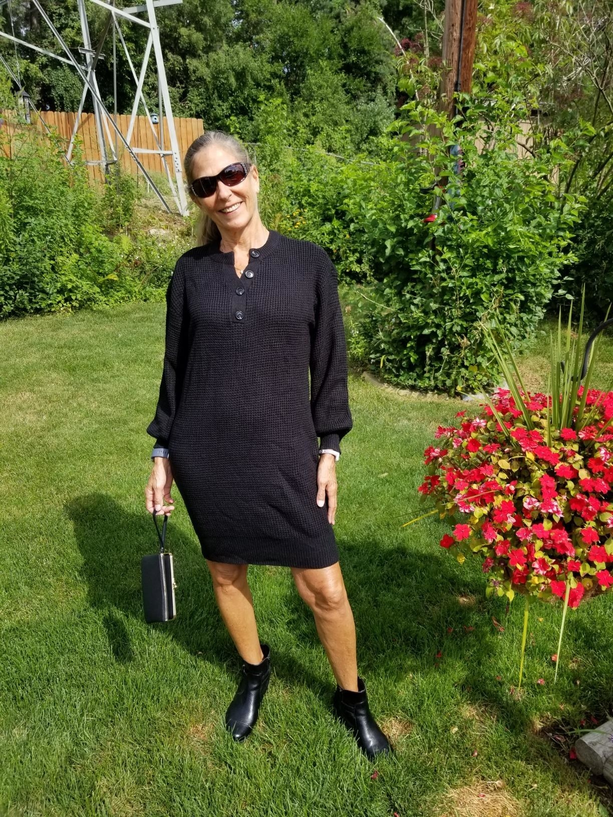 A reviewer wearing the knee-length dress in black