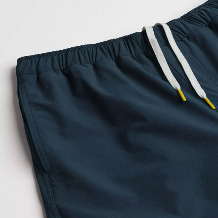 A close-up of some dark green workout shorts