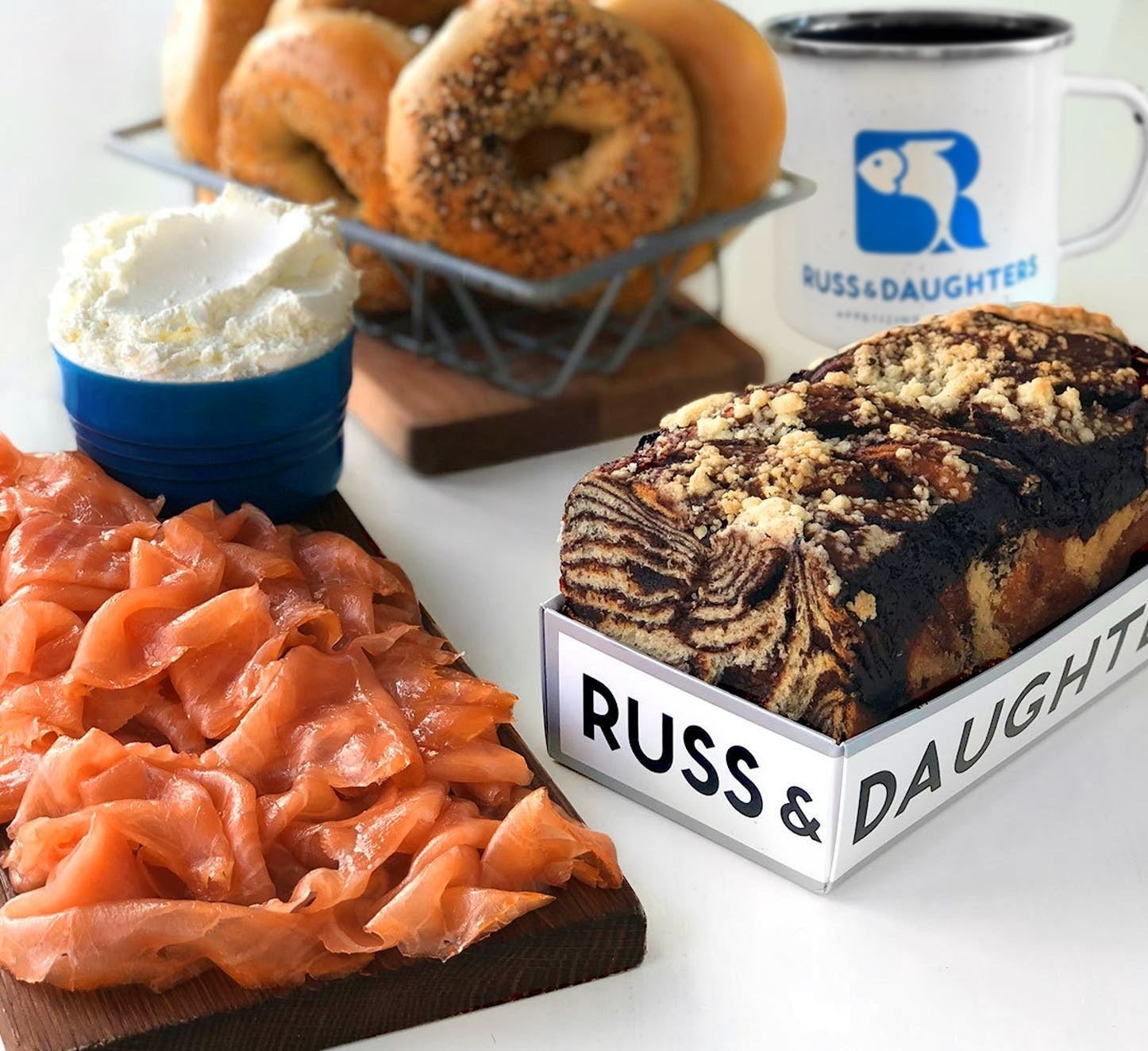 assortment of lox, bagels, cream cheese, coffee, and chocolate babka