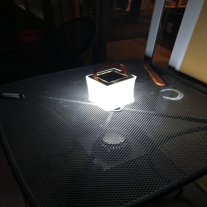Reviewer image of the lantern giving off light
