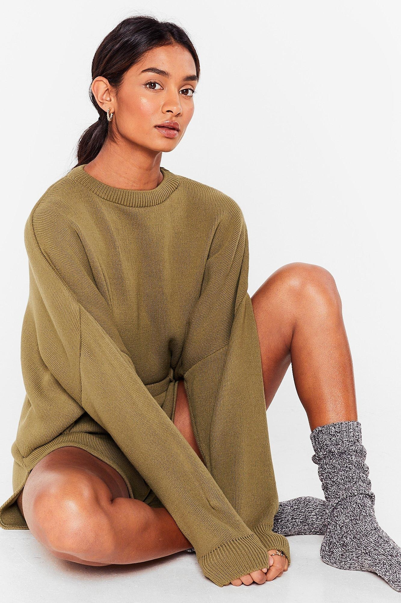 Model wears olive green sweater and shorts lounge set
