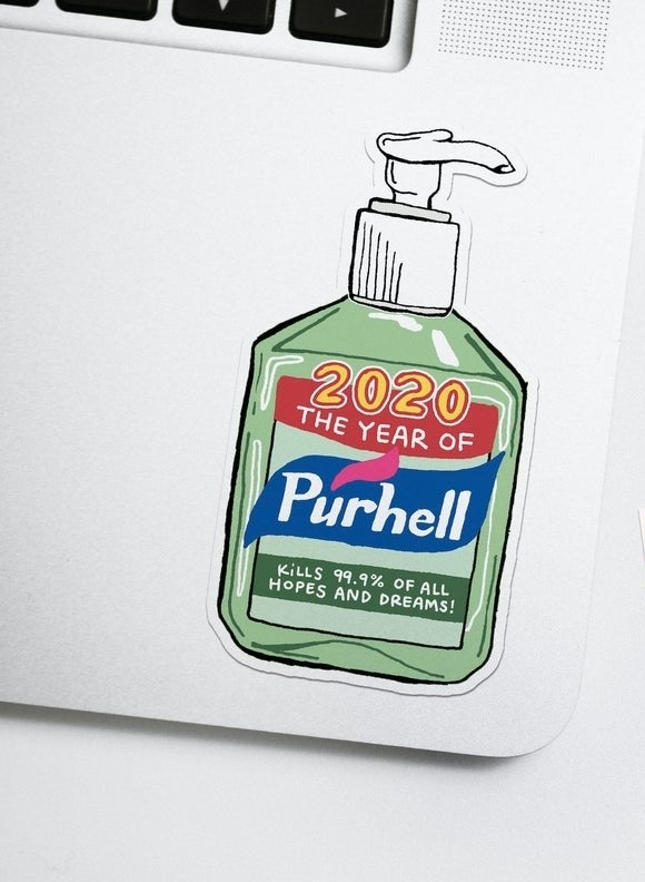 the purhell sticker place on the corner of a laptop