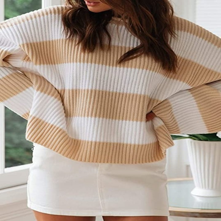 the sweater in light brown stripes