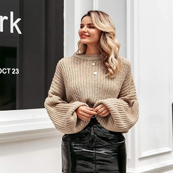 model in the brown sweater