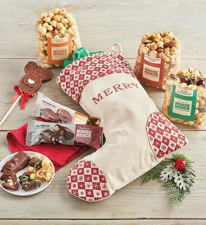 Stocking with several types of popcorn, chocolate, and suckers around