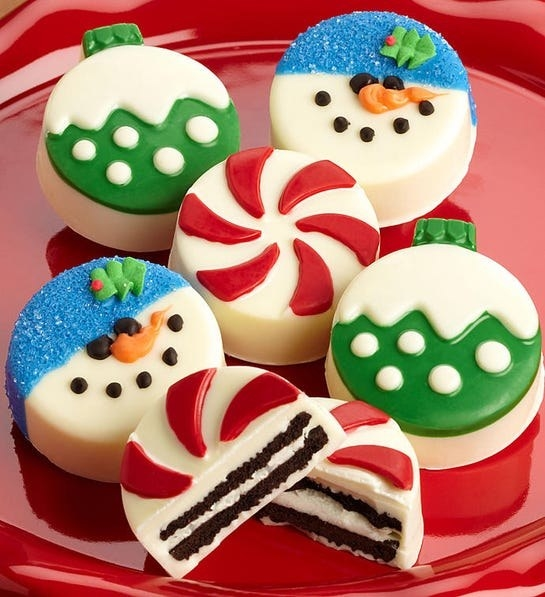 Six round cookies with festive mints, snowman, and ornament chocolate details