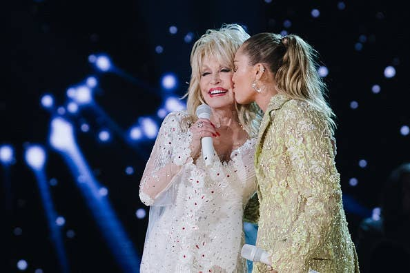 Miley kissing Dolly's cheek on stage at the Grammy's