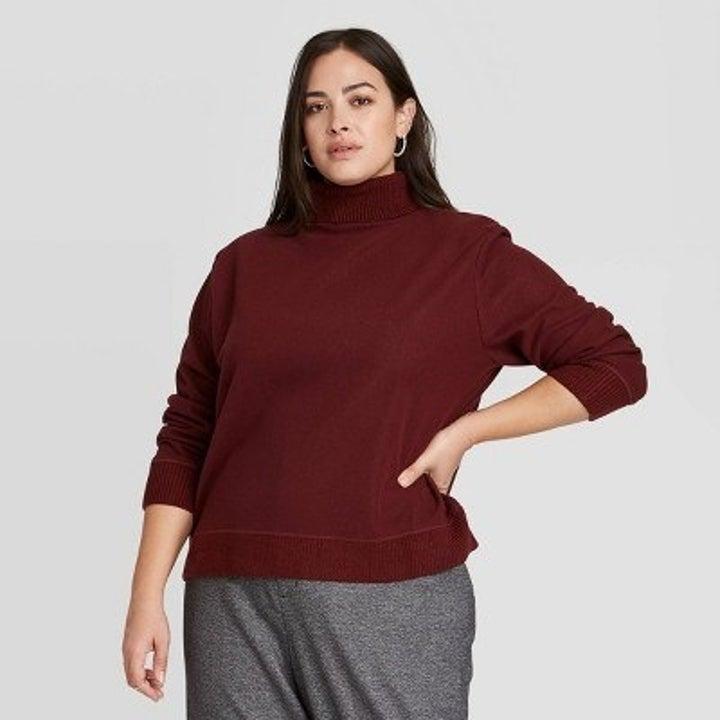 Model wearing burgandy turtleneck