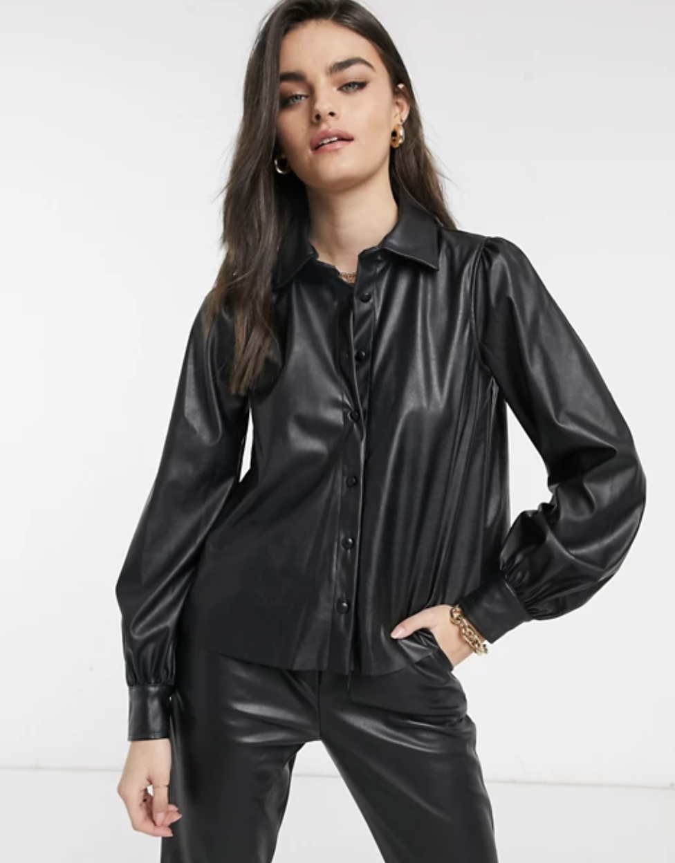 Model wearing faux leather button-down shirt