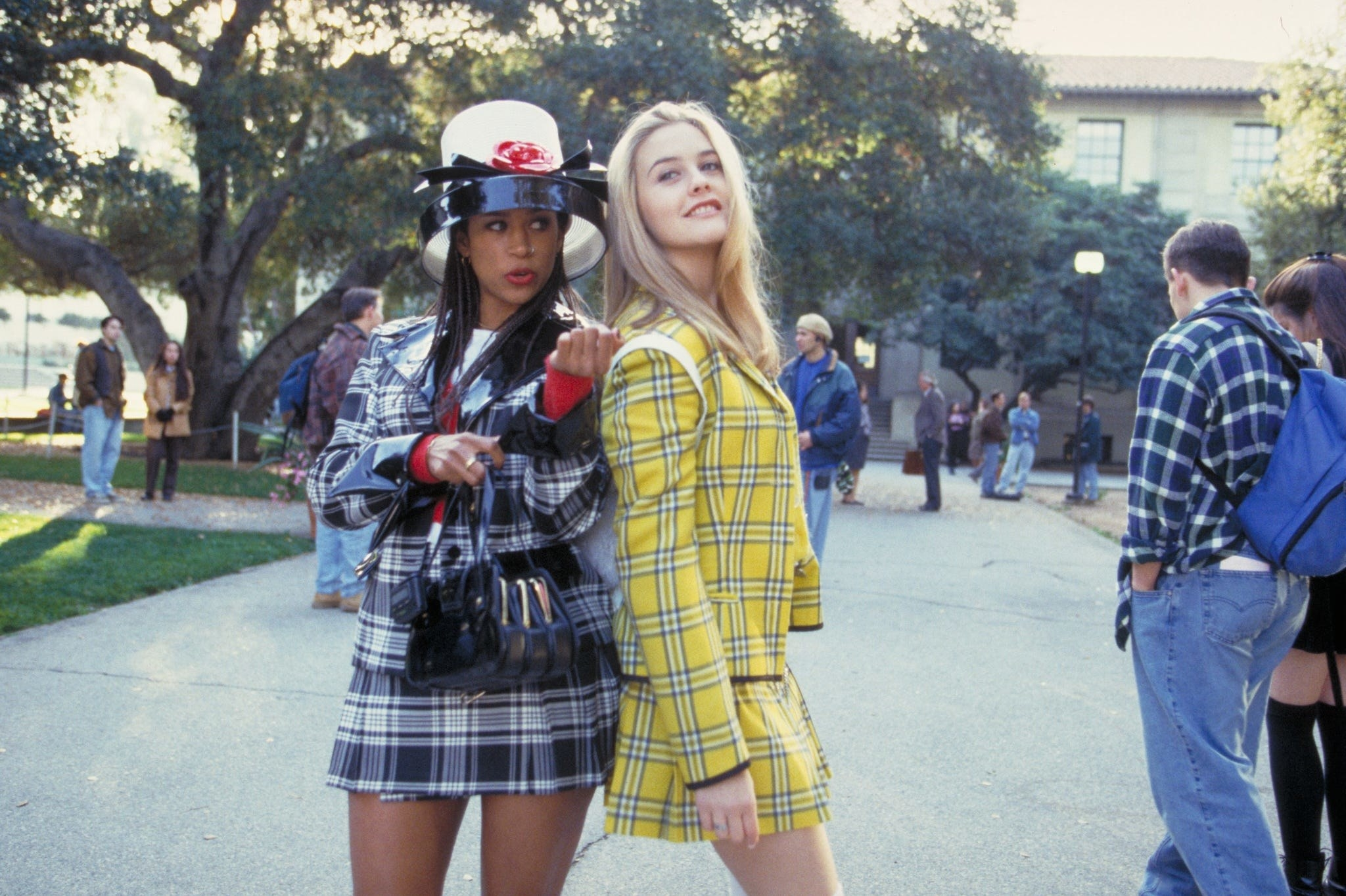 Dionne and Cher at school, wearing matching plaid blazers and skirts