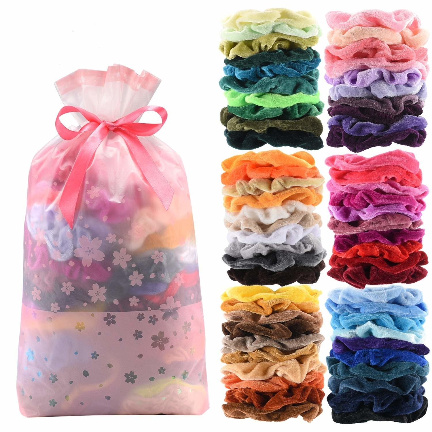 Set of colorful velvet scrunches in a pink floral pouch