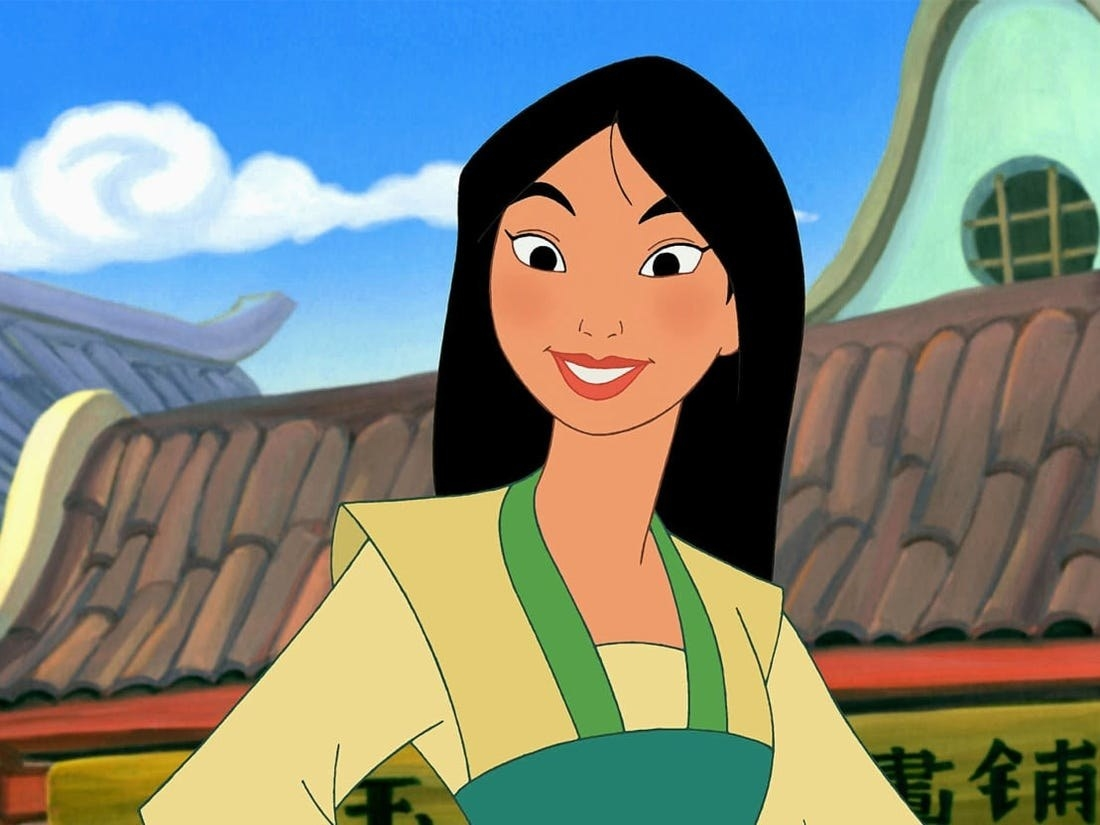 Mulan with her hands on her hips, smiling