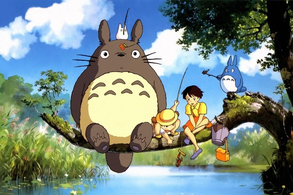 Totoro and some children sitting on a tree branch while fishing