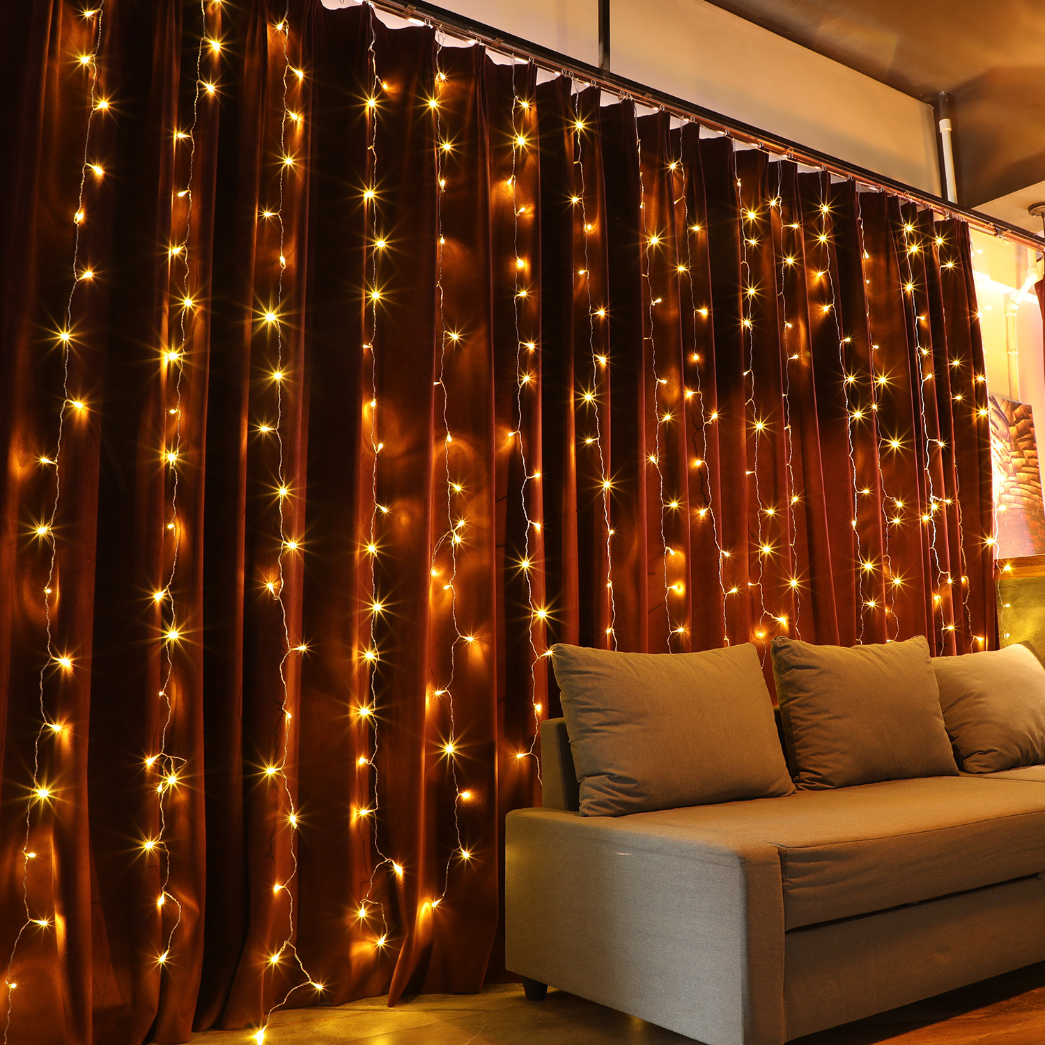 the lights hung on the curtains behind a couch