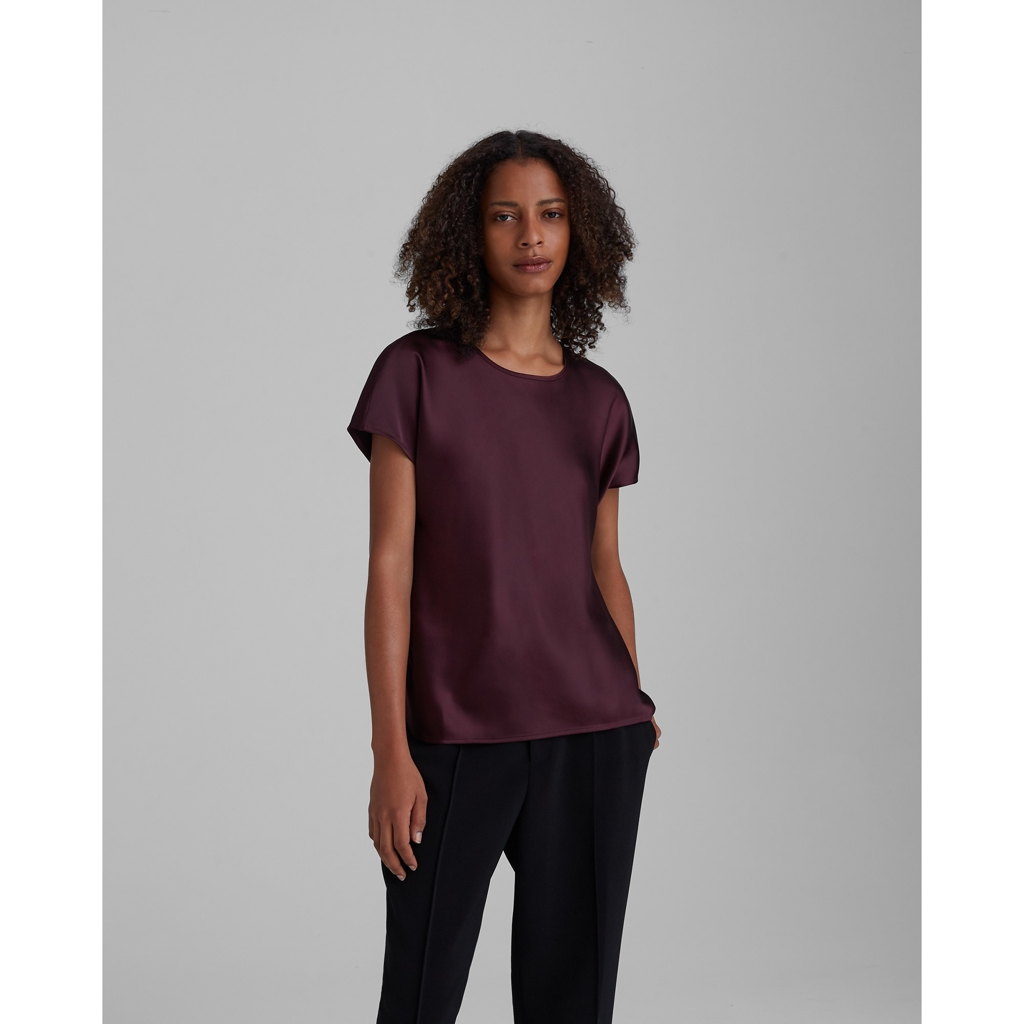 model posing in a silk t-shirt