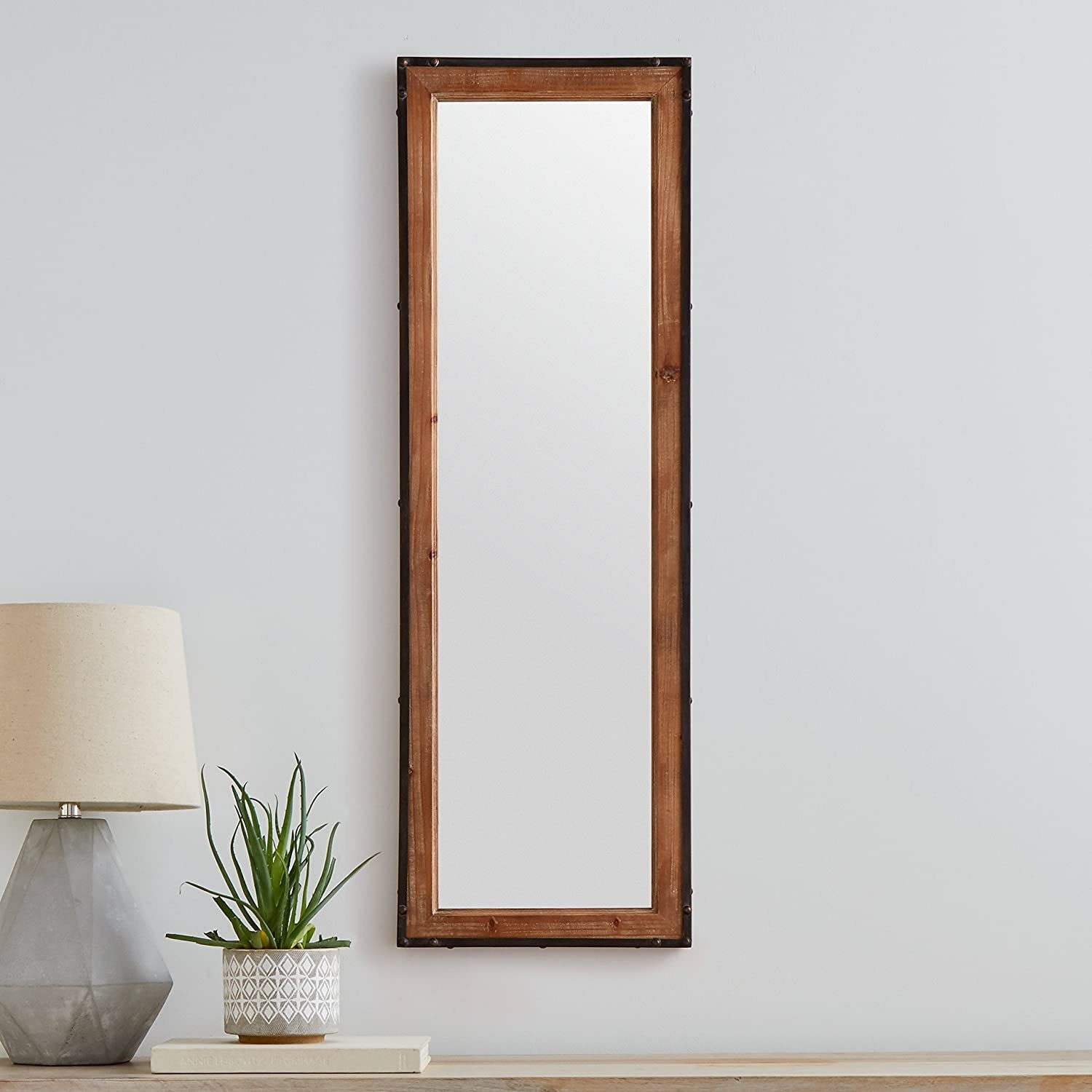 A full length mirror on a wall