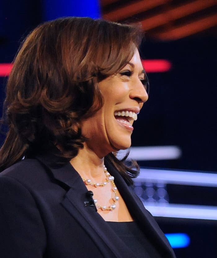 Kamala Harris smiling and looking to the right.