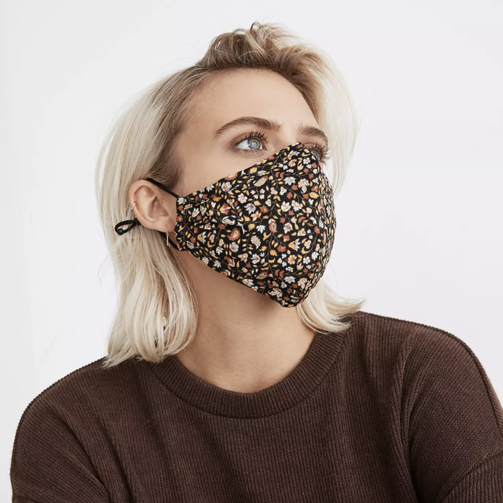 Model wearing face mask with floral print